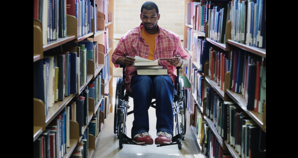 Man in wheelchair in library