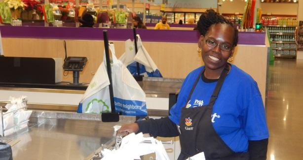 Charlene Taylor working at Giant in the checkout lane.