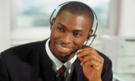 Man with a a headset, person on the phone helping a customer.
