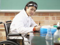 Young Asian student in lab with a wheelchair